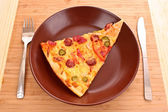 Tasty Italian pizza on plate — Stock Photo