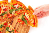 Hand and Pizza isolated on white — Stock Photo