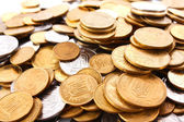 Many coins background — Stock Photo