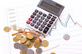 Calculator and coins on chart background. (Ukraininan coins) — Stock Photo