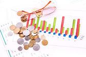 Coins, glasses and charts (Ukraininan coins) — Stock Photo