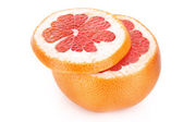 Slice and a half of grapefruit isolated on white — Stock Photo