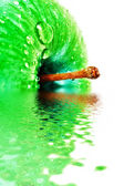 Green apple closeup with waterdrops in water — Stock Photo