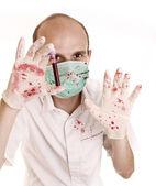Beyaz izole kan test tüpü tutan genç erkek bilim — Stok fotoğraf
