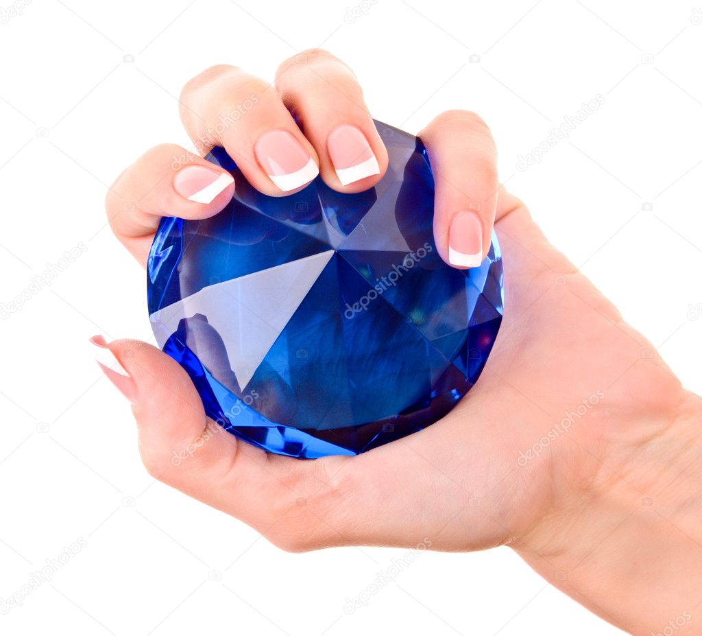 Giant blue diamond in hand isolated on white — Stock Photo #6783848