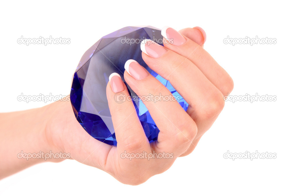 Giant blue diamond in hand isolated on white  Stock Photo #6783859