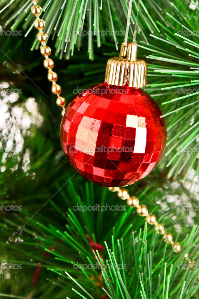 Red Christmas balls  among green new year tree — Stock Photo #6786819