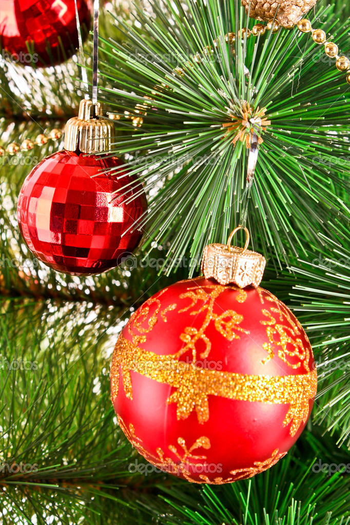 Red Christmas balls  among green new year tree  Stock Photo #6786833