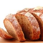 Bread on wooden surface — Stock Photo