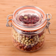Haricot in jar on wooden table — Stock Photo