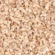 Uncoocked rolled oats as texture - Stock Photo