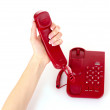 Dialing on the red phone — Stock Photo