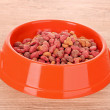Cats food on wooden table — Stock Photo
