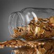 Coins spilling from money jar on gray background — Stock Photo #6792133
