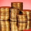 Coins on red background — Stock Photo #6792266