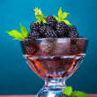 Stock Photo: Beautiful blackberries in glass