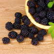 Beautiful blackberries in wooden bowl - Stock Photo