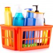 Stock Photo: Bottles of beauty and bath products in orange box isolated on wh