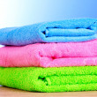 Towels on blue background — Stock Photo