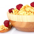 Royalty-Free Stock Photo: Tasty cornflakes and fruit in wooden bowl