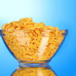 Tasty cornflakes in glass bowl - Stock Photo