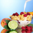 Tasty cornflakes, fruit and milk in glass bowl  — Stock Photo