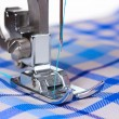 Stock Photo: Sewing machine and blue fabric