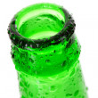 Macro shot of beer bottle with water drops isolated on white — Stock Photo