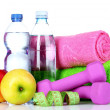 Towel, dumbbells and water bottle - Stock Photo