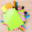 Bright stationery on wooden background — Stock Photo