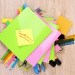Stock Photo: Bright stationery on wooden background