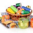 Bright threads in basket — Stock Photo