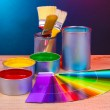 Open cans with bright colors, brushes and palette on wooden table — Stock Photo