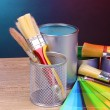 Open cans with bright colors, brushes and palette on wooden table — Stock Photo #6793456