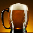 Mug of beer on a yellow background — Stock Photo #6793482