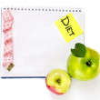 Stock Photo: Planning of a diet. Notebook, pencil and fresh apples isolated on white