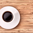 Coffee cup on wooden surface — Stock Photo #6793823