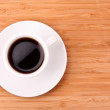 Coffee cup on wooden surface — Stock Photo #6793824