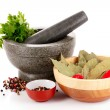 Mortar and pestle, parsley, bay leaf and pepper isolated on whit - Stock Photo