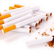 Many cigarettes isolated on white — Stock Photo