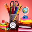 Stationery on red background — Stock Photo