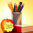 Stationery and apple on yellow background — ストック写真