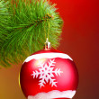 Royalty-Free Stock Photo: Beautiful Christmas red ball on fir tree
