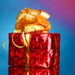 Beautiful gift with gold bow - Foto Stock