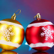 Beautiful Christmas balls on blue background - Stock Photo