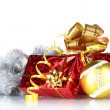 Beautiful gifts with gold bows and Christmas ball - Stock Photo