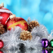 Beautiful Christmas ball, cones and tinsel — Stock Photo