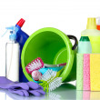 Detergent bottles, brushes, gloves and sponges in bucket — Stock Photo #6794732
