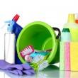 Detergent bottles, brushes, gloves and sponges in bucket — Stock Photo #6794732