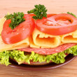 Stock Photo: Sandwich on wooden table
